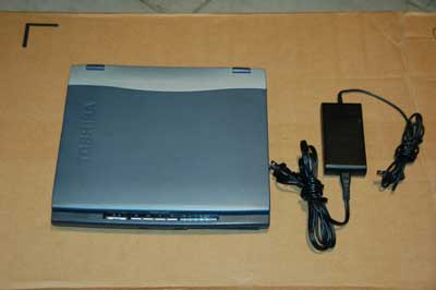 used laptop with Windows XP Pro, serial port and floppy drive